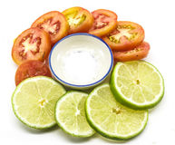 Lime and tomato slice with salt stock image