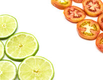 Lime and tomato slice Royalty Free Stock Photos