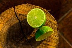 Lime on a tree trunk cut Stock Photos
