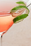 Lime twist garnish. Closeup of a martini garnished with a fresh lime twist royalty free stock photo