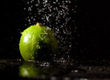 Lime under water jets Stock Photos