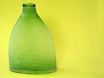 Lime Vase. Lime colored vase on yellow background royalty free stock images
