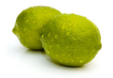 Lime with water drops Stock Photos