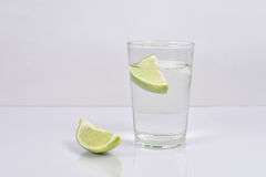 Lime water. Lime in the glass of water in bright, lime with block Royalty Free Stock Photo
