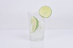 Lime water. Lime in the glass of water in bright, lime with block Stock Images