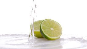 Lime and water splash. On a white background Royalty Free Stock Image