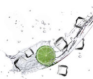 Lime with water splash and ice cubes. Over white Stock Photos