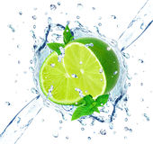 Lime and water splash Stock Photography
