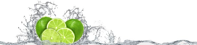 Lime and water splash on white background. Large format lime with water splash on white background. Citrus fruit with water splash Stock Photography