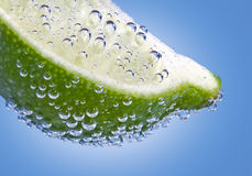 Lime Wedge and Bubbles Royalty Free Stock Images