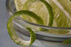 Lime wedges and twists Stock Photography
