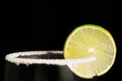 Lime wheel and salt on the rim of a glass Stock Photography