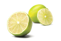 Lime on white background. Half of lime on white background. on background cut a lime Stock Photos