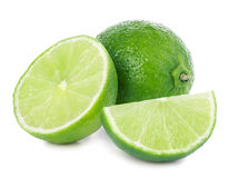 Lime. Whole lime with slices isolated on white background Stock Photos