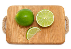 Lime on wooden cutting board Royalty Free Stock Photo