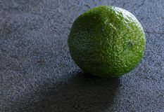 Lime. On working desk. Prepared for next use in the kitchen royalty free stock image