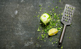 Lime zest and grater . Lime background. On stone table. Stock Photo