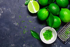 Lime zest and lime close up on a concrete background Royalty Free Stock Photography