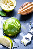 Lime and zest, natural refreshing ingredients. On dark slate stock images