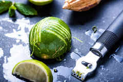 Lime and zest, natural refreshing ingredients and zest, natural. Lime and zest, natural refreshing ingredients on dark slate stock photography