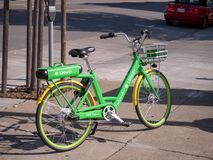 LimeBike, dock free electric bikeshare, e-bike parked in middle stock images
