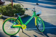 LimeBike left on a parking lot in San Francisco bay area. April 20, 2018 San Mateo / CA / USA - LimeBike left on a parking lot in San Francisco bay area stock photography