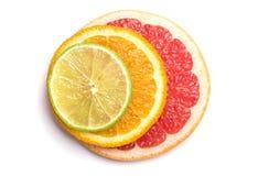 Limefrukt, apelsin och grapefrukt arkivfoto