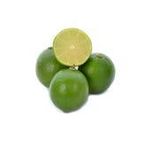 limefrukt frukt med en halva Arkivbilder