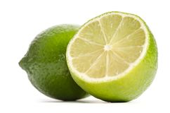 Limefrukt och halva av limefrukt fotografering för bildbyråer