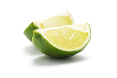 limefrukt pieces två arkivfoton