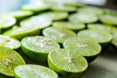 limefruktbakgrunder, slut sköt upp Royaltyfri Bild