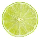 Limefruktskiva som isoleras på vit bakgrund arkivbild