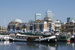 Limehouse Basin,London. General view of Limehouse Basin,with luxury waterside apartments and Canary Wharf` skysrapers on the background royalty free stock photos