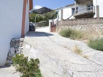 Street in Limenaria, Thasos. Limenaria is a village on the island of Thasos in northern Greece. The village numbers 2480 residents 2011 census and is the second Royalty Free Stock Photos