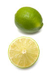 Limes. Fresh whole and sliced limes on a white background Stock Image