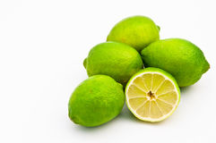 Limes. Fresh limes still ripening on white royalty free stock images