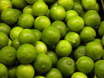 Limes. A bunch of fresh green limes Royalty Free Stock Photography