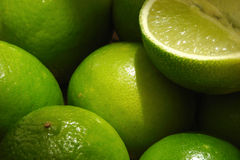Limes. Some pieces of a lime Stock Photo
