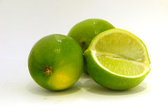 Limes. Some pieces of a lime Stock Image