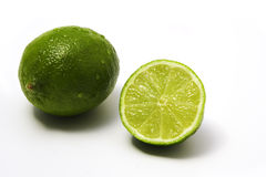 Limes. A full and a half lime fruit, white background royalty free stock image
