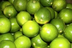Limes. Colourful display of bright green limes Stock Photo
