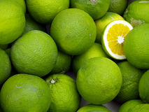Limes. On a market stand Stock Photos