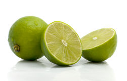 Limes. Green limes fruits on a white background Stock Photography