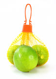 Limes in a bag Royalty Free Stock Photography