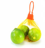 Limes in a bag Stock Photography