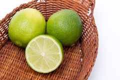 Limes in a basket stock image