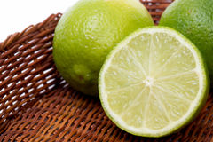 Limes in a basket closeup Stock Image