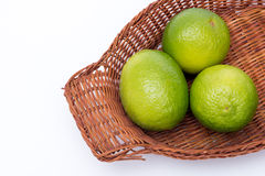 Limes in a basket Stock Images