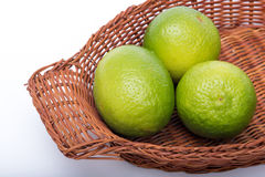Limes in a basket Royalty Free Stock Image