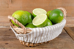 Limes in a basket Stock Photo